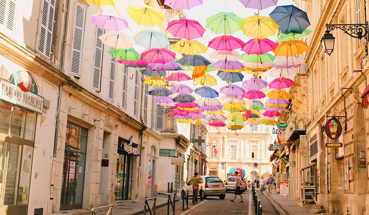 colorful umbrellas hanging over street in france
